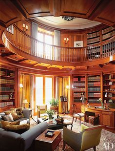 The double-height library of a Toronto home by decorator Katherine Newman and architectural designer Peter Cebulak features mahogany- and satinwood-inlaid paneling and carved Ionic capitals.