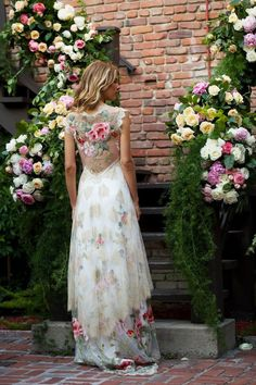 The Chantilly lace of the Heart's Desire wedding dress will cascade over your silhouette aspink and red peonies embroidered on flowing tulle dance across th...
