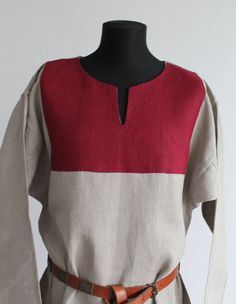 Viking age linen tunika Basic Viking tunic made of 100 % linen fabric natural color. It has simple T-shape pattern. The tunic has two gores, one on each side. Inside stitches are machine and hand made, every visible stitches are made by hand.  When ordering, write the measurements Length from shoulder to hem Sleeve length Chest, waist, hips.  Jewellery and belt are not included.   Thanks for visiting my shop