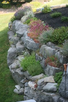 Rock Garden on retaining wall.                                                                                                                                                     More #RockGarden