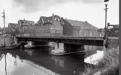1960. A view of the Veelaan in Amsterdam-Oost. The Veelaan is a street in the former Oostelijk Havengebied of Amsterdam. The street takes its name from the old cattle market and city abattoir that were located nearby. Some of the buildings are still standing. Since the redevelopment of the area the street has become an important traffic artery connecting the Indische Buurt with the the Oostelijk Havengebied. Stadsarchief Amsterdam. #amsterdam #1960 #Veelaan