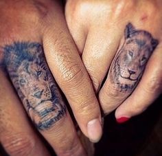 lion and lioness little tattoos on the fingers