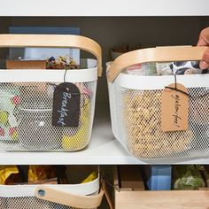 Use IKEA RISATORP white steel mesh storage baskets arranging food by mealtime or by allergy. Stylish storage baskets for small kitchens & pantries. Organisation Ikea, Ikea Kitchen Organization, Kitchen Ikea, Kitchen Pantry Storage, Kitchen Storage Containers, Larder Storage, Kitchen Baskets, Kitchen White, Kitchen Island