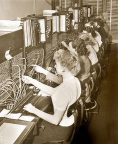 Studebaker Switchboard Operators - South Bend, Indiana    In 1953, the switchboard operators at Studebaker were buzzing. From front to back: Joyce Jennings, Gail Brandenburg, unknown, Laura Swihart, unknown, Betty Grooms, and unknown.