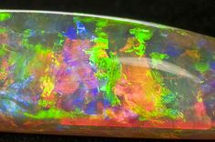 The Rainbow Opal - Weighing carats, it is a uniform, solid block of intense colour discovered in Coober Pedy in It is also extraordinarily rare – being an opalised fossil of a belemnite, an ancient squid-like creature over 100 million years old. Minerals And Gemstones, Crystals Minerals, Rocks And Minerals, Stones And Crystals, Opal Australia, South Australia, Rainbow Opal, Cool Rocks, Rocks And Gems