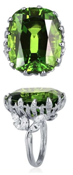 35.23 Carat Peridot Diamond Platinum Ring, Stunning platinum peridot ring consisting of 1 cushion cut peridot having a total weight of 35.23 carats accompanied by a gemological report. The stone is set in a handmade leaf pattern mounting with round diamond accent stones.