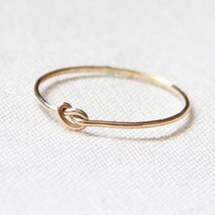 BACKORDERED - One Tiny Memory Knot - Knotted Thread of Gold Ring - Stacking Ring - Delicate Jewelry - Memory Ring. $9.75, via Etsy.
