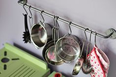 Bygel rails for hanging play kitchen pots, pans, and utensils - Works great! We added the Ikea hanging dish drainer, too.