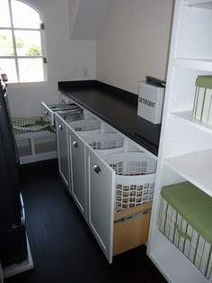 laundry room hampers | Hampers in a vanity for sorting dry cleaning and laundry. Someday my laundry room will be this organized – unfortunately by then I won't probably need it as much