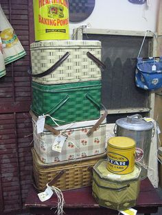Vintage metal picnic baskets - they look beautiful stacked -