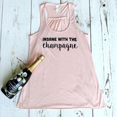 Insane with the Champagne - Our favorite racerback tank is back in this bubbly design ;)  Also available in a unisex tee in an additional listing.  Our tees are screen printed with high-quality ink to help prevent fading from constant washing. We know clothes go through the ringer, so we make sure that our methods ensure a very durable and crisp print. They will not crack or peel like shirts printed with vinyl. We use tri-blend tees which give our shirts that amazingly soft feel. Sizes…