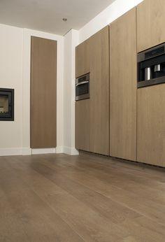 Keukenkasten tot aan het plafond. Optimaal gebruik maken van de hoogte