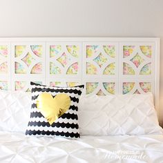 Happiness is Homemade used vintage sheets and wooden cutouts painted white to create this bright and cheerful headboard. Find the directions at Happiness is Homemade »   - CountryLiving.com