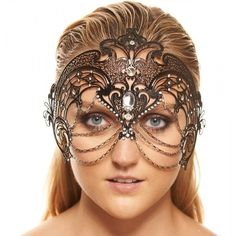 Exotic Full Face Laser Cut Mask w Chains -Made with eco-friendly metal material. -Laser Cut -Beautiful Rhinestones design.  -One size fits most. -Perfect for masquerade balls, weddings, proms, parties, dances, music festivals, raves, Mardi Gras, etc. K2012 Accessories