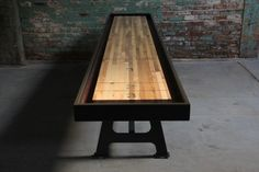 Custom made shuffle board tables formed from reclaimed wood.  I want one for the house!