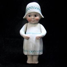 5 1/4 in. Antique German Googly Eye All Bisque Doll with Molded Hat