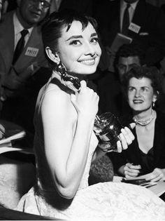 Audrey Hepburn holding her Oscar award
