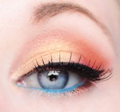 Peach eyeshadow with blue liner... 80s throwback, but I like it. Pinned from the MakeupGeek.com (AKA MUG) idea gallery.