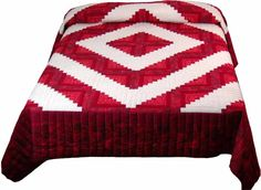 "LOG CABIN BARN RAISING VARIATION MADE BY LINDA They say that ""everything old is new again."" Red and white quilts are very old fashioned, and you don't see them often. So we're introducing Red and White Modern Chic! This diamond shaped variation of the Log Cabin design is called Barn Raising."