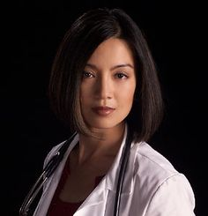 """Ming-Na was Dr. Jing-Mei 'Deb' Chen on ER.  She is the first Asian-American woman on a soap, """"As the World Turns"""".    You can hear Ming in Disney's animated movie, """"Mulan"""" and """"Mulan 2"""", and as Detective Ellen Yin in the animated series, """"The Batman"""".    *Interesting fact: Ming and her husband, screenwriter Eric Zee, manage an Asian-American boy band named At Last. The band was a finalist on the reality series, """"America's Got Talent"""".....  NBC Official Site"""
