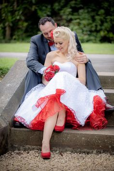 me & my husband! rockabilly polka dot wedding dress. red petticoat, red shoes, red rose bouquet. pinup hair, victory rolls. blonde curls