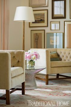 Vintage tufted armchairs once belonged to the homeowner's grandmother. - Traditional Home ®/ Photo: John Bessler / Design: Lisa Hilderbrand with Sarah Hamlin Hastings