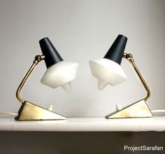 Vintage Lamps. Pair of Quirky Midcentury Small Bedside Lamps with Glass Lampshade, Gray and Brass Detail. Atomic. Eames. €195.00, via Etsy.