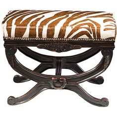Love this carved bench with brown and white zebra and nail head trim.