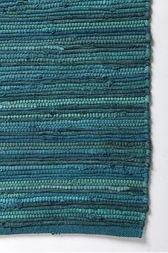 Love the variegated teal blue color of this rag rug
