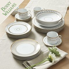 The sophisticated look of this dinnerware was inspired by an old Parisian set Bunny Williams has collected for years. The pattern is designed to mix and match with other pieces for everyday elegance and any occasion.  Bunny Williams Gold Star Dinnerware Plate features: White porcelain 20-Piece Set includes 4 each of Dinner Plates, Salad/Dessert Plates, Bowls & Cups w/SaucersReal gold decorationDishwasher safeNot for use in microwave