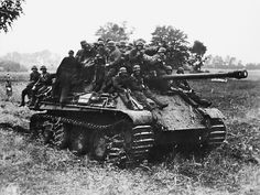 Elements of the 10th SS Panzer Division Frundsberg move to counter-attack British positions on Hill 112, southwest of Caen, in late June 1944.