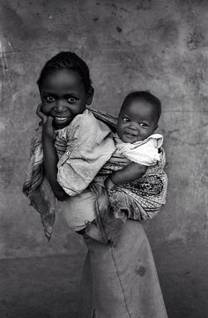Sisters. Kangaware Slums, Kenya Some day all God's beautiful children will live in peace and prosperity. I so look forward to that day.