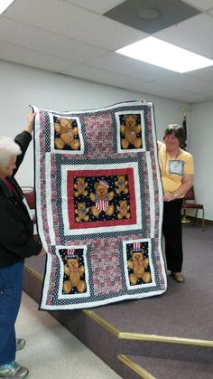 Veteran's quilt I made November 2014 - Thanks, Irene, for helping to hold it.
