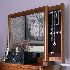 Small Spaces Vanity Mirror in a Harvest Brown finish at D Noblin Furniture...Small Spaces is designed with the mantra of how we get the most of small spaces! Finished in a rich Harvest Brown color and features Nickel cup pulls for hardware. Beveled, slide out back panels for jewelry storage.