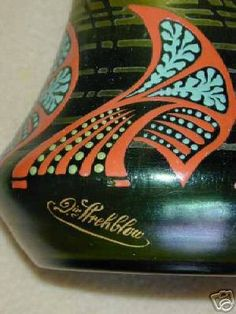 "Gorgeous, almost 11-inches tall, carved, enameled blown vase of good size decorated in the Art Deco fashion. It is mildly iridescent, ground looks almost like stretch or crackle glass.    It is signed, ""Dir Strehblow."" Heinrich Strehblow (born 1862 in Vienna), was an important Bohemian glass designer who introduced the Art Deco style between the world wars. His work brought him international recognition."