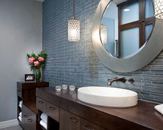 A #happy #modern #bathroom #design with #dark stained #cabinets, #fresh white #towels, and #pendant #lights that are to die for.  The #blue #tile does wonders for this #bath! #modern #bathroom