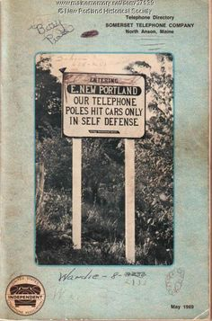 """This directory has a photograph of a sign that reads """"Entering E. New Portland our telephone poles hit cars only in self defense"""" which was placed in East New Portland by the Village Improvement Society, 1969. Item # 27139 on Maine Memory Network"""
