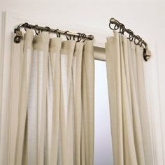 Replace your curtain rods with swing arm rods to open up the room and allow more light in. Windows appear to be bigger than they are, too. Love swing arm curtain rods, I have been on the hunt for old ones for a long time. Diy Casa, Drapery Rods, Swing Arm Curtain Rods, Corner Curtain Rod, Corner Window Curtains, Curtain Divider, Home And Deco, My New Room, Window Coverings