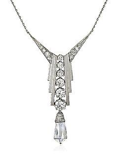 n Art Deco diamond pendant of geometric design centering on a row of graduating round diamonds terminating in a diamond briolette drop, in platinum; with original fitted case. Alabaster & Wilson (jm)