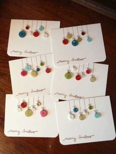 Colorful button Christmas cards. Set your creativity on the roll with these Christmas cards made out of paper and extra buttons.
