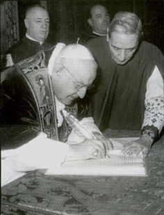 """This is a photograph of Pope John XXIII signing the document that officially started the Second Vatican Council. After his death, Pope Paul VI continued the council which was to change the Catholic Church so much that has become barely a reflection of what it was before. On his deathbed, John XXIII is rumoured to have said """"Stop the council!"""" Vatican City 1960"""
