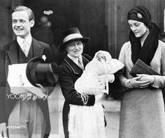 Mr and the Hon. Mrs Bryan Guiness (the former Diana Freeman Mitford), pictured at the christening of their elder son, Jonathan Bryan, at St. Margaret's, Westminster. His godparents were Evelyn Waugh, Randolph Churchill, Peregrine Willoughby, Cecilia Keppel and Miss Rosemary Mitford. The baby is seen being held by his nurse. Mr & Mrs Bryan Guinness at christening of their son, Jonatha circa 1930