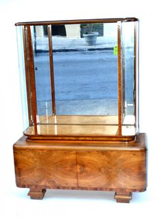 Art Deco Vitrine       Vitrine, is a glassed-in cabinet or display case for displaying delicate or valuable articles such as objets d'art or merchandise in a shop, museum, or house. And in French the word Vitrine means a storefront window.