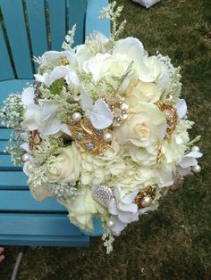Arthouse Floral- Antique broches and fresh flowers! what a mix