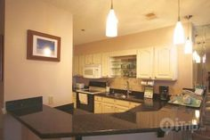 Cozy and comfortable! This kitchen has plenty of counter space for the family to enjoy when on vacation.