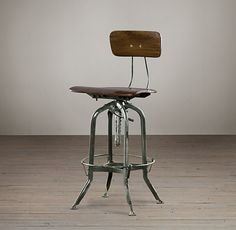 Toledo chair from Restoration Hardware.  They stole their design from Toledo Metal Furniture Company, who made the original drafting stools in Ohio in the early 1900s, but are no longer in business.  Love the look, but plan to find an original and try to restore it (more authentic)