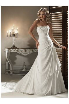 This is pretty but I would only wear it if it had straps.  Sleeveless.  Every wedding gown I see lately is strapless!  Boringggggggg!  Let's see something new!