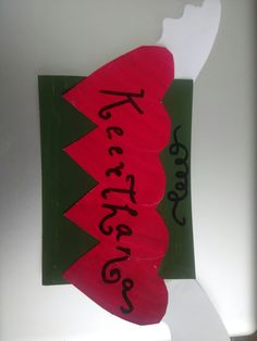 A simple door hanger or sticker, which is done with greeting card paper and acrylic colors.