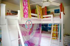 The girls room triple bunk bed reading nook behind the curtain