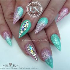 Shimmery Pink & Mint Green Nails  Inspired by @margaritasnailz  Sculptured Acrylic with @youngnailsinc Neon Blue, Neon Green, Rainbow White, Indigo Metallic Pink, @inmnails Tropical Collection Precious Gems, @touchedbycolournailart Swarovski Crystal Raindrops AB & Crystal Moonlight. #youngnails #indigo #inm #swarovskicrystals #raindrops #crystalmoonlight #metallicpink #mint #green #pink #pastel #acrylicnails #shiny #shimmer #glitter #icing #frosting #nailart #luminous #byteena #luminousna...